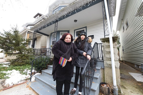 Carmen Acosta and her granddaughter Teanna Palacio at their home which now has power again on Summit Avenue in Phillipsburg. (Tim Wynkoop | lehighvalleylive.com contributor)