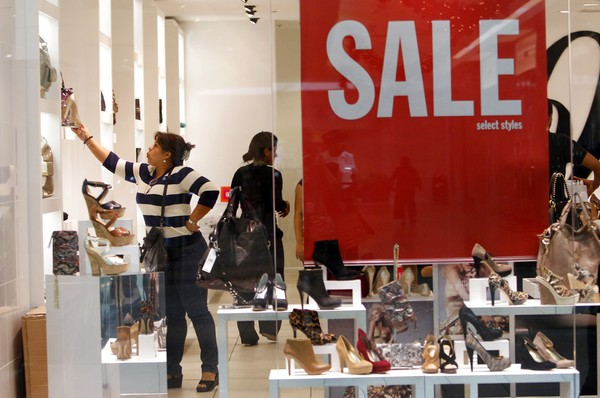 This Nov. 25, 2011, file photo shows people shopping for shoes at Nine West on Black Friday at Dadeland Mall, in Miami.