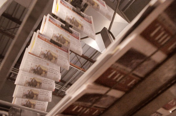 Completed editions of The Express-Times wind their way through the mailing room during a press run in 2013.